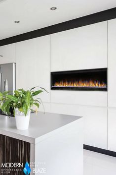 Minimalistic, frameless, modern linear electric fireplace for a kitchen. Affordable Bedding Sets, Wall Outlets, Living Spaces, Luxurious Bedrooms, Luxury Bedroom Sets, Room Remodeling, Kitchen Fireplace, Minimalist Design, Fireplace