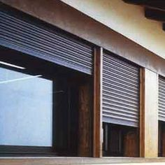 Security, storm, hail or hurricane shutters serve many purposes.  MUST BE HIDDEN ABOVE for security. http://www.stormshutters.com/shutters/hurricane-shutters.html