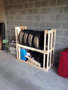 Tyre rack made with 2 repurposed pallets.
