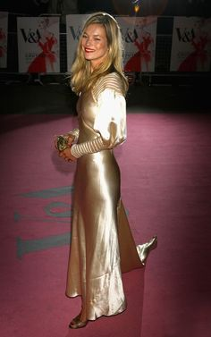 40 Dresses With Their Own Wikipedia Entries: Gold Satin Christian Dior Dress Of Kate Moss at the Age of Couture VIP Gala, 2007.