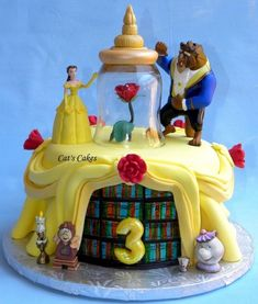 A cake featuring three gumpaste dolls of Disney Princesses, Cinderella, Snow White and Belle (Beauty and the Beast). Description from cakecentral.com. I searched for this on bing.com/images