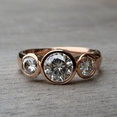 Pinned Image This is recycled rose-gold and some stone called Moissanite. It's a fabricated carbonate stone modeled after some meteorite. but it's shiny and pretty. Bridal Rings, Wedding Rings, Gold Wedding, Bridal Jewelry, Dream Wedding, Bezel Set Ring, Rose Gold Engagement Ring, Wedding Engagement, Love Ring