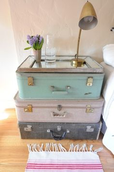 Take a creative cue from Emily of Cupcakes and Cashmere and scour your local flea market for antique suitcases.  Stack a few, top with a mirror, and you have a quirky side table with character!