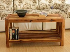 "Teak Slat Coffee Table With Storage Shelf 36"" x 16 x 18 "" Solid one inch square slats on a two inch square frame - visually interesting piece that makes a bold statement. Solid Plantation grown Teak wood with a functional storage shelf below."