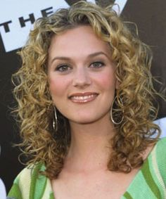 Layered hair cuts are one of the most suitable haircuts for short to medium length soft curly hair. It is easier to maintain and give your curls a good structure.