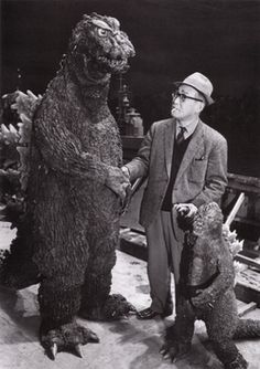 """godzilla shaking hands with his """"admiring"""" public,sorry he cant give autographs no aposable thumbs"""