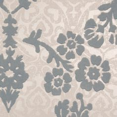 Portia Wallpaper A distinguished flock wallpaper with a layered, hand-printed feel. In grey and silver.