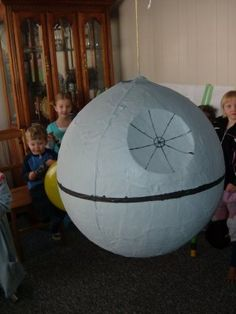 Death Star Pinata made from punching balloon and paper mache. Indent made by cutting out a circle and inverting it.