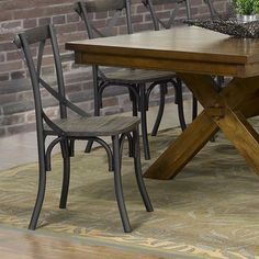 The Fargo sidechairs from !nspire in black are the perfect accompaniment to a gorgeous wood dining table!     http://worldwidehomefurnishingsinc.com/fargo-side-chair-in-black.html