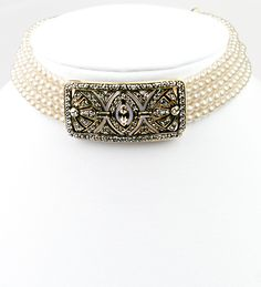 Signature vintage designer Heidi Daus multiple pearl strands adjustable choker. This piece contains clear and black diamonds, and smoky quartz pave set Swarovski crystals in a rectangular shiny metal