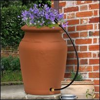 Rain Barrels - yes summer will be coming and the ideas are endless with ways to catch and reclaim today's rain for tomorrows needs.  Garden smart and give your plants natures best water - rain