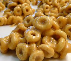 Peanut Butter Cheerio Balls~we drizzled with white & chocolate almond bark~yum!