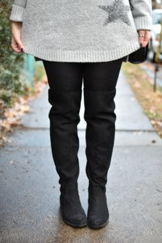 Over the knee boots, leather leggings, and a cozy gray sweater
