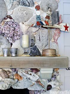 """The living room fireplace is made of concrete embedded with stones, shells, and barnacles. """"I've collected them from all over the world,"""" Liza Pulitzer Calhoun says."""