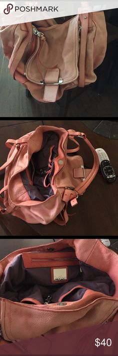 Soft leather purse. Bought it at Nordstrom's Very nice soft leather purse. When I bought it, it was more of a watermelon color and it began to fade, it's about a year old and now it looks more like salmon color. Very sturdy with tons of life but I am over the color. Kooba Bags Hobos
