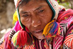 Peruvian Shaman adorned in Traditional Peruvian colors