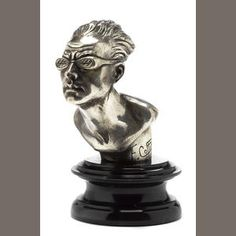 A Swimmer wearing goggles mascot, by F. Coffin, French, c. 35,  signature below shoulder of Mascot, fine detail, bronze nickel plated, mounted on marble display base, 6½in high overall.