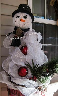 Snowman From Tomato Cages I am in love with the snowmen trees that I am seeing this year. I created a snowman to stand guard at my house this year. He is made from two tomato cages, a glass light globe and a whole bunch of deco ribbon. His head was filled Snowman Tree, Cute Snowman, Snowman Crafts, Christmas Projects, Holiday Crafts, Holiday Decor, Snowmen, All Things Christmas, Holiday Fun