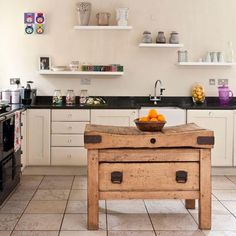 rustic country kitchen an eclectic touch is added with a quirky wooden antique butcher u0027s block  this neutral kitchen is the epitome of traditional farmhouse     large white kitchen with vintage butcher block  by designer susan      rh   pinterest com