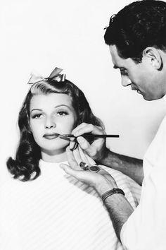 1. 1940 2. Clay Campbell applying makeup to Rita Hayworth 3. http://hollywoodlady.tumblr.com/post/77800970684/barbarastanwyck-clay-campbell-applying-makeup 4. age unknown