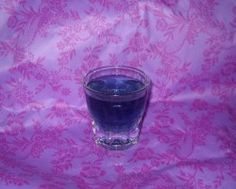 Use 3/4 of a shot of grape vodka, 1/4 shot of blue curacao, and a generous splash of cranberry juice. Shake it up over ice and strain into a shot glass. Tastes like the Grape Gatorade Shot.