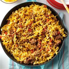Chili Beef Noodle Skillet Recipe -A friend gave me this recipe. My husband, Walter, likes this entree's hearty blend of beef, onion and tomatoes. I like it because I can get it to the table so quickly.—Deborah Elliott, Ridge Spring, South Carolina