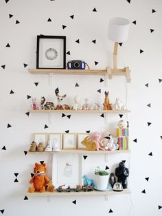 Design Woe: Flat white walls Stylish Solution: Art, textiles and temporary vinyl sticks/wallpaper