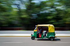 tuk tuk - panning shot of a tuk tuk running in a street of Delhi in India