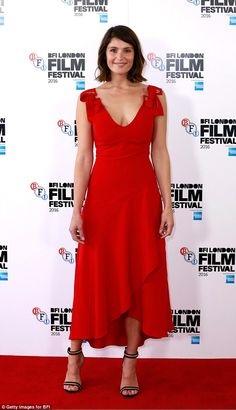 Red hot: Gemma Arterton looked beautiful as ever in a bright dress as she attended the Their Finest photocall during the 60th BFI London Film Festival in London on Thursday