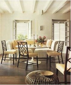 Saarinen table with modern-traditional chairs