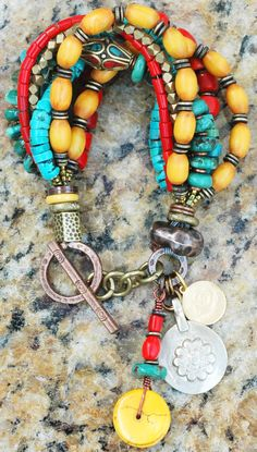 Kathmandu Charm Bracelet: Tibetan-Inspired Turquoise, Yellow, Red and Bronze Charm Bracelet $195