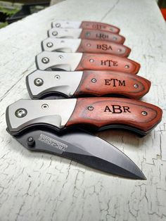 Pocket Knife, Groomsmen Gift, Groomsmen Knife, Personalized Knife, Engraved Knife, Groomsmen Gifts, Custom Knife, Hunting Knife  Engraved Pocket knife includes engraving of name, date or initial. This is perfect for a groomsman gift, birthday, fathers day, or any holiday.  Choose the quantity of knives you need. These knives are SPRING ASSISTED TAC-FORCE KNIFES with a wooden handle. These are great gift knives!  Details: Spring assisted blade 4 3/8 closed Stainless steel locking blade Wooden…