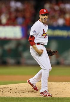 Cardinals starting pitcher Joe Kelly reacts after striking out Dodger Yasiel Puig stranding two runners to end the top of the 1st inning of ...