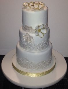 Three tier wedding cake with edible lace made by students in the cake decorating classes in 2015.  inquiries about the classes may be emailed to tania@cakearts.co.za or taniariley@vodamail.co.za  www.cakearts.co.za      www.facebook.com/taniarileycakeartist