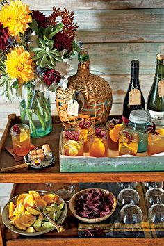 Warm and Rustic Bar Cart - Handsome Bar Cart Ideas - Southernliving. Set a proper bar with flowers, cocktail mixers, garnishes, and the signature beer cocktail. Here, we served Lost in Texas. Bourbon Apple Cider, Hard Apple Cider, Spiked Cider, Cider Cocktails, Fall Cocktails, Bridal Shower Punch, Spiced Wine, Thanksgiving Cocktails, Thanksgiving Recipes