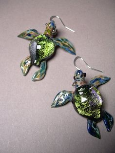 One pair of Sea Turtle Earrings blown glass by Glassnfire on Etsy, $56.00