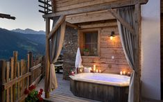 Book a Luxury-Chalet in Austria – modern lifestyle with rustic charm. The Almdorf Sankt Johann im Pongau – 11 Luxury-Chalets for winter holidays. Outdoor Tub, Romantic Resorts, Alpine Village, Wood Stone, Best Interior, Interior Design, Bath Remodel, Travel With Kids, Outdoor Living