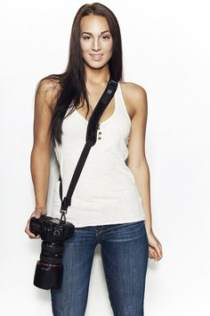 Black Rapid Camera Sling. It's even curved for our boobs. Oh yes, this is on my Photo Lust List.