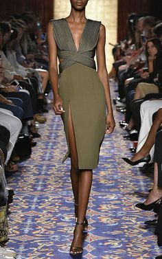 This **Brandon Maxwell** dress features a v-neckline and a sheath silhouette.