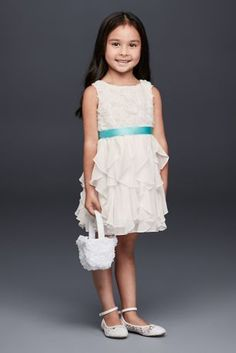 This charming flower girl dress features a bodice of swirly rosettes and a tiered and ruffled chiffon skirt. Removable satin ribbon sash Polyester Back zipper; fully lined Dry clean Imported Inc