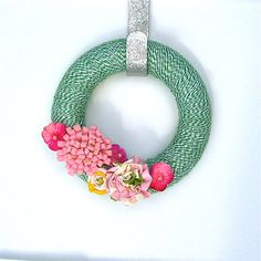 THIS blog post at The Crafted Sparrow has 20 of THE MOST gorgeous Spring Wreaths...this is one of my favs, but so many pretty ones, hard to choose. I assume the links tell who made them, and how...