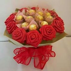 Origami Rose with Chocolate Bouquet 12 Roses 12 Chocolates Rose dimension: 3 W x 10 H Bouquet dimension: 12 W x 11 H Rose material: Paper Rose c Liquor Bouquet, Candy Bouquet Diy, Paper Bouquet, Diy Bouquet, Rose Bouquet, Paper Origami Flowers, Paper Roses, Candy Flowers, Nylon Flowers
