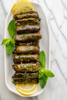 Lebanese Stuffed Grape Leaves (Warak Enab): These Lebanese Stuffed Grape Leaves (Warak Arish) are made with a spiced ground beef and rice mixture - a delicious Mediterranean dish commonly served as an appetizer! Plats Ramadan, Bon Dessert, Ramadan Recipes, Ramadan Food, Lebanese Recipes, Mediterranean Dishes, Mediterranean Couscous, Le Diner, Middle Eastern Recipes