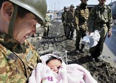 A little girl is 4 months miraculously rescued by soldiers after 4 days in the ruins of the Japanese tsunami..
