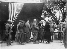 """Each applicant for American Red Cross assistance in the refugee camp was required to submit to an examination as to his need, etc., then a card was issued to him if his case was deemed a proper one for American Red Cross aid. But before he could collect his allotted ration, he must take his card around to the American Red Cross bath house, take a bath, and get the card properly stamped. """"No meal without a bath"""" is the American Red Cross rule everywhere in the Balkans American Red Cross, Romania, Cards, Meal, Bath, House, Food, Bathing, Home"""