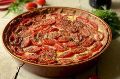 Lækker tærte med løg, hvidløg, chili, rosmarin og timian og selvfølgelig masser af friske tomater.