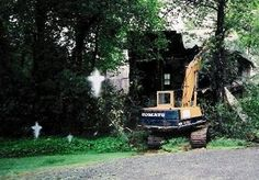 """CROSSES APPEAR IN PICTURE! * Michael writes, """"This picture was taken in a small village called Blackville, NB. the house is located right beside a graveyard. the picture was taken by friends of my sister as the house was being torn down."""