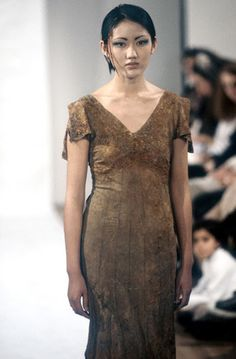 "Hussein Chalayan, a dress from ""The Tangent Flows"", 1994 MA collection dress buried in the ground with iron filings then exhumed."