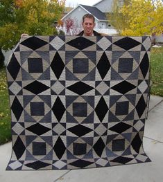 "Storm at Sea - made from old pants from thrift store - black denim, khaki and cords.  Blocks are large and finish 24""."