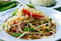 Green Papaya Salad (Som Tam) - Did you know... Traditionally, green papaya salad is served with rice and grilled chicken or with rice noodles and crispy pork skin?